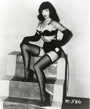 Betty Page with whip